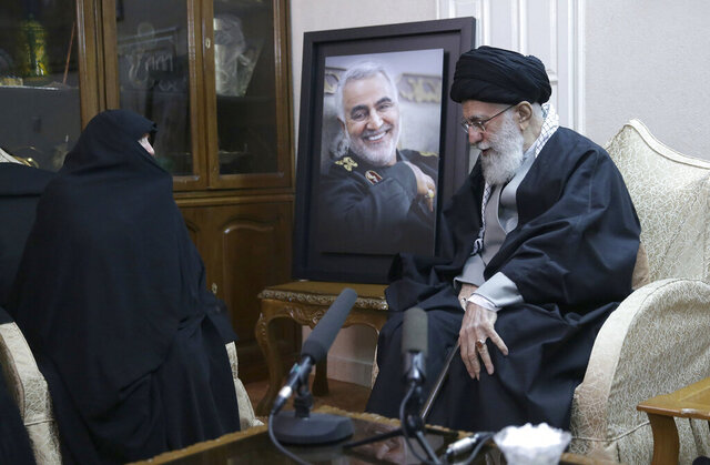 In this picture released by the official website of the office of the Iranian supreme leader, Supreme Leader Ayatollah Ali Khamenei, right, meets family of Iranian Revolutionary Guard Gen. Qassem Soleimani, who was killed in the U.S. airstrike in Iraq, at his home in Tehran, Iran, Friday, Jan. 3, 2020. Iran has vowed