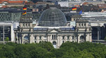 In this Tuesday, May 8, 2018 photo the Reichstag Building, host of the German federal parliament, is photographed in Berlin, Germany. German voters elect a new parliament on Sunday, Sept. 26, 2021, a vote that will determine who succeeds Chancellor Angela Merkel after her 16 years in power. (AP Photo/Michael Sohn)