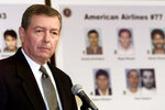 FILE - In this Thursday, Sept. 27, 2001 file photo, U.S. Attorney General John Ashcroft meets with reporters at FBI headquarters in Washington, where he released photographs of the 19 suspected hijackers. In the wake of 9/11, he was the administration's prime advocate of the USA PATRIOT Act, which gave the government broad powers to investigate and prosecute those suspected of terrorism. (AP Photo/Joe Marquette, File)