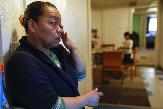 Janeth wipes away tears as she worries about how to feed her family, Wednesday, April 15, 2020, in Washington. Since this image was taken Janeth and her husband Roberto have been diagnosed with COVID-19. (AP Photo/Jacquelyn Martin)