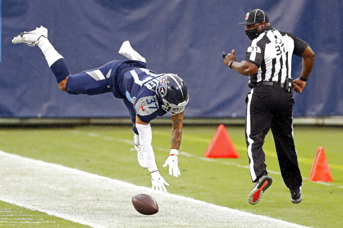 Tennessee Titans safety Amani Hooker (37) falls as he breaks up a pass against the Houston Texans in the first half of an NFL football game Sunday, Oct. 18, 2020, in Nashville, Tenn. (AP Photo/Wade Payne)