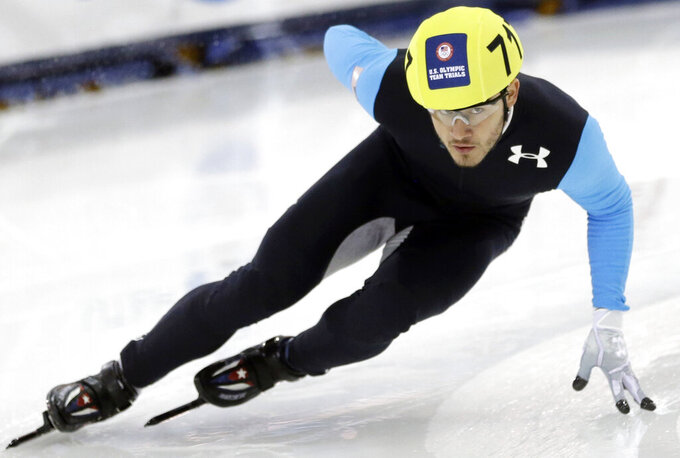 FILE - In this Jan. 5, 2014, file photo, Eduardo Alvarez competes in the men's 1,000-meters during the U.S. Olympic short track speedskating trials in Kearns, Utah. Alvarez became only the third American to earn medals at both the Summer and Winter Olympics when the United States beat defending-champion South Korea 7-2 Thursday night, Aug. 5, 2021, to gain a berth into this weekend's gold medal game against host Japan. (AP Photo/Rick Bowmer, File)