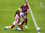 PSG's Grace Geyoro, left, and Barcelona's Caroline Graham Hansen compete for the ball during the Women's Champions League semifinal second leg soccer match between FC Barcelona and Paris Saint- Germain at the Johan Cruyff stadium in Barcelona, Spain, Sunday, May. 2, 2021. (AP Photo/Joan Monfort)