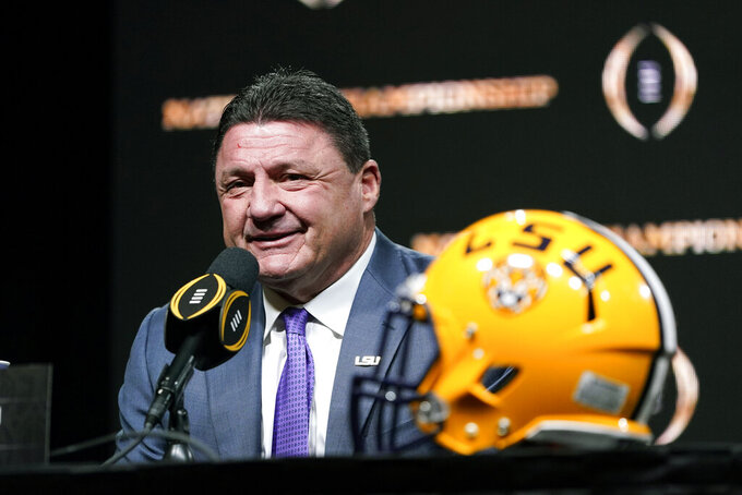 "FILE - In this Jan. 12, 2020, file photo, LSU head coach Ed Orgeron speaks during a news conference for the NCAA College Football Playoff national championship game in New Orleans. LSU coach Ed Orgeron is looking to add a defensive back to the 2020 Tigers at a time when uncertainty caused by the coronavirus pandemic could theoretically help him land an established player from another major conference. ""We're a little short"" at cornerback,"" Orgeron said during a video media conference Tuesday, Aug. 25, 2020. (AP Photo/David J. Phillip, FIle)"