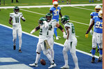 New York Jets running back La'Mical Perine, secdond from left, celebrates after scoring against the Los Angeles Chargers during the first half of an NFL football game Sunday, Nov. 22, 2020, in Inglewood, Calif. (AP Photo/Jae C. Hong)