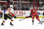 Calgary Flames defenseman Noah Hanifin (55) defends against Carolina Hurricanes right wing Andrei Svechnikov (37), of Russia, during the second period of an NHL hockey game in Raleigh, N.C., Tuesday, Oct. 29, 2019. (AP Photo/Gerry Broome)