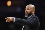 "FILE - In this Feb. 21, 2020, file photo, Cleveland Cavaliers coach J.B. Bickerstaff points during the first half of the team's NBA basketball game against the Washington Wizards in Washington. Cleveland's three major professional sports franchises--the Browns, Cavaliers and Indians--are teaming up to fight social injustice. One day after the NBA postponed playoff games _ and other leagues followed suit _ amid a player-led boycott to protest the shooting of a Black man by police in Wisconsin, the Cleveland teams announced their alliance to ""develop a sustainable and direct strategy to address social injustice facing the city and all Northeast Ohio communities."" (AP Photo/Nick Wass, File)"