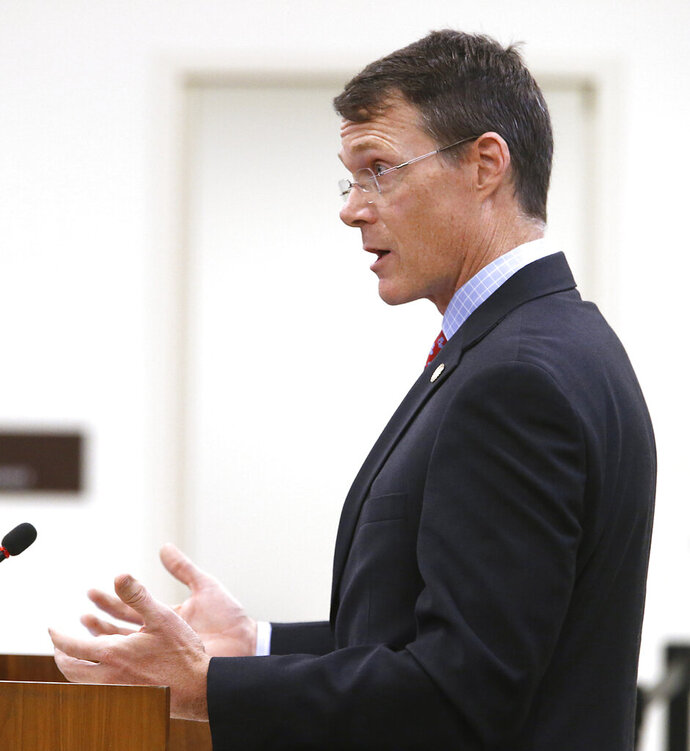 FILE - In this Tuesday, Dec. 4, 2018, file photo, Dr. Hughes Melton, commissioner, Department of Behavioral Health and Developmental Services, speaks during a meeting in Richmond, Va. Melton, the top mental health official in Virginia, has died from injuries he suffered in a three-car crash, Wednesday, July 31, 2019, in which an 18-year-old woman was killed. (Alexa Welch Edlund/Richmond Times-Dispatch via AP, File)