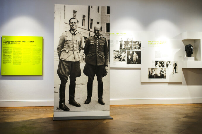 In this Friday, July 12, 2019 photo a picture of Claus Schenk Graf von Stauffenberg, left, and Albrecht Ritter Merz von Quirnheim is displayed a the exhibition at the German Resistance Memorial Center inside the Bendlerblock building of the defensive ministry in Berlin. Stauffenberg was one of the leaders of the failed assassinate to Adolf Hitler one July 20, 1944. (AP Photo/Markus Schreiber)