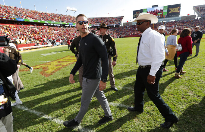 Texas Tech head coach Kliff Kingsbury, center, walks off the field after an NCAA college football game against Iowa State, Saturday, Oct. 27, 2018, in Ames, Iowa. (AP Photo/Charlie Neibergall)