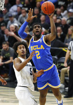 UCLA forward Cody Riley, right, drives to the rim for a basket past Colorado guard D'Shawn Schwartz in the first half of an NCAA college basketball game Thursday, March 7, 2019, in Boulder, Colo. (AP Photo/David Zalubowski)