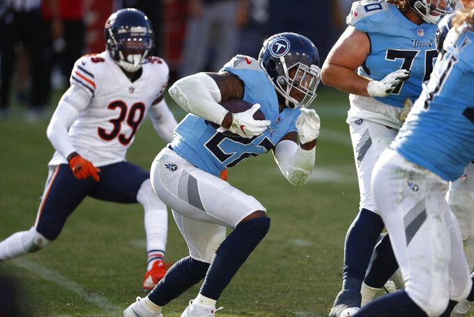 Tennessee Titans running back Derrick Henry (22) carries the ball against the Chicago Bears in the second half of an NFL football game Sunday, Nov. 8, 2020, in Nashville, Tenn. (AP Photo/Wade Payne)