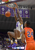 LSU forward Emmitt Williams (24) dunks the ball in front of Auburn forward Anfernee McLemore (24) in the first half of an NCAA college basketball game, Saturday, Feb. 9, 2019, in Baton Rouge, La. (AP Photo/Bill Feig)