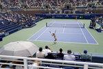 Camila Giorgi, of Italy, serves to Simona Halep, of Romania, during the first round of the US Open tennis championships, Monday, Aug. 30, 2021, in New York. (AP Photo/John Minchillo)