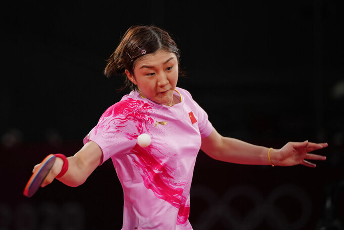 China's Chen Meng competes during the table tennis women's singles quarterfinal match against Hong Kong's Doo Hoi-kem at the 2020 Summer Olympics, Wednesday, July 28, 2021, in Tokyo. (AP Photo/Kin Cheung)