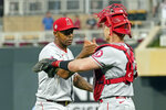 Los Angeles Angelsr relief pitcher Raisel Iglesias, left, and catcher Max Stassi celebrate their win over the Minnesota Twins in a baseball game, Saturday, July 24, 2021, in Minneapolis. (AP Photo/Jim Mone)
