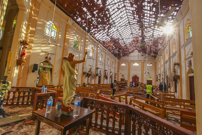 FILE - This Sunday, April 21, 2019, file photo shows the inside of St. Sebastian's Church damaged in a blast in Negombo, north of Colombo, Sri Lanka. Police say President Maithripala Sirisena is opposed to having them testify before a parliamentary inquiry into intelligence failures that preceded the Easter Sunday suicide attacks that killed more than 250 people. (AP Photo/Chamila Karunarathne, File)