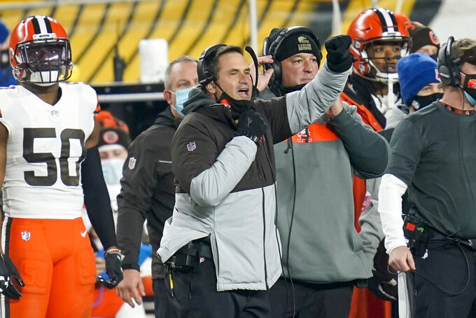 Cleveland Browns acting head coach Mike Priefer, center, gives signals during the first half of an NFL wild-card playoff football game against the Pittsburgh Steelers, Sunday, Jan. 10, 2021, in Pittsburgh. (AP Photo/Keith Srakocic)