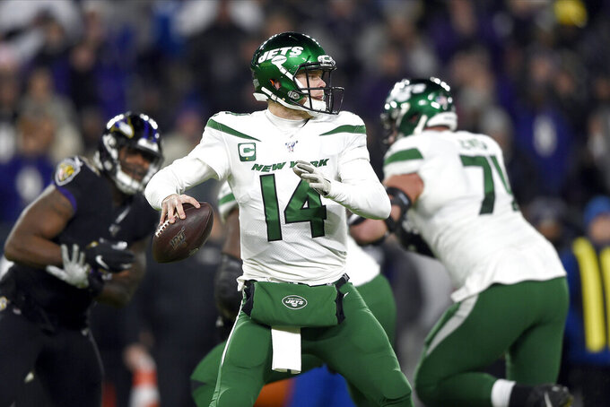 New York Jets quarterback Sam Darnold looks to pass against Baltimore Ravens during the first half of an NFL football game, Thursday, Dec. 12, 2019, in Baltimore. (AP Photo/Gail Burton)