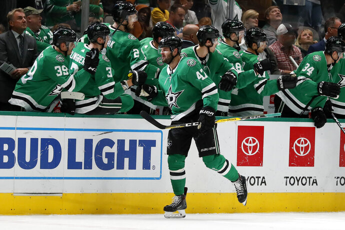 Dallas Stars right wing Alexander Radulov (47) is congratulated by the bench after scoring against the Minnesota Wild in the second period of an NHL hockey game in Dallas, Tuesday, Oct. 29, 2019. (AP Photo/Tony Gutierrez)