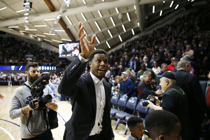 Kyle Lowry, a former Villanova player and current Toronto Raptors player, waves to the crowd after a ceremony honoring him during an NCAA college basketball game between Villanova and St. John's, Wednesday, Feb. 26, 2020, in Villanova, Pa. (AP Photo/Matt Slocum)