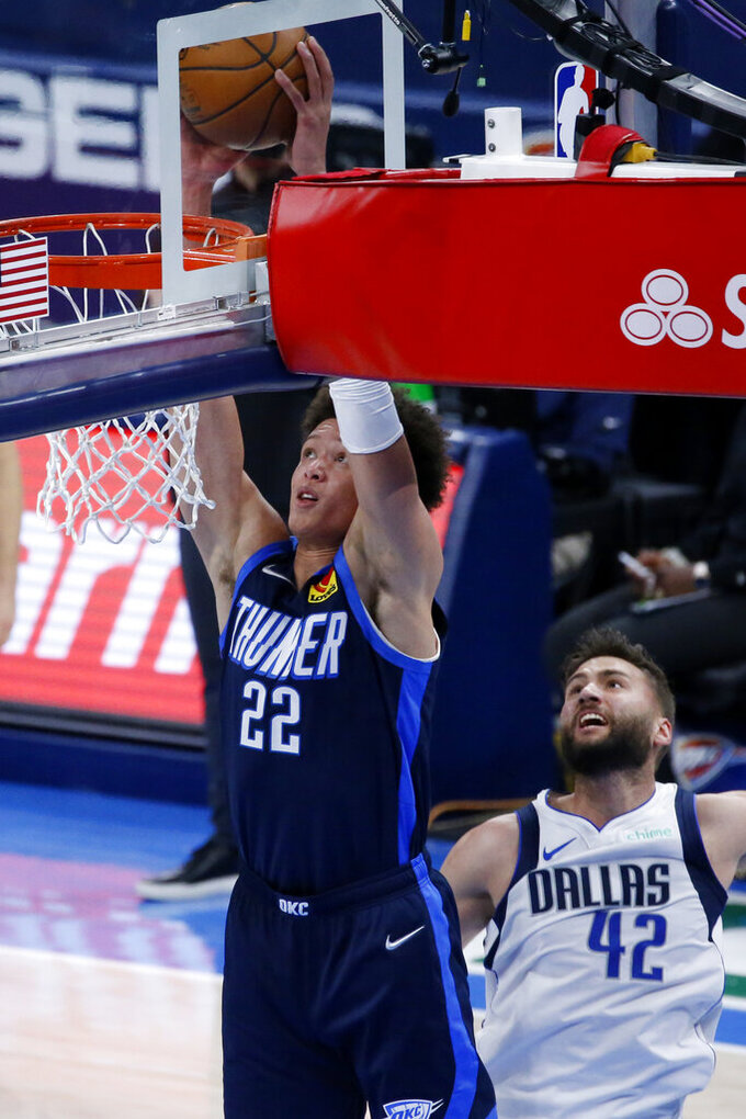 Oklahoma City Thunder center Isaiah Roby (22) takes a shot against Dallas Mavericks forward Maxi Kleber (42) during the first half of an NBA basketball game, Thursday, March 11, 2021, in Oklahoma City. (AP Photo/Garett Fisbeck)