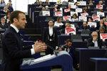 European lawmakers raise placards reading