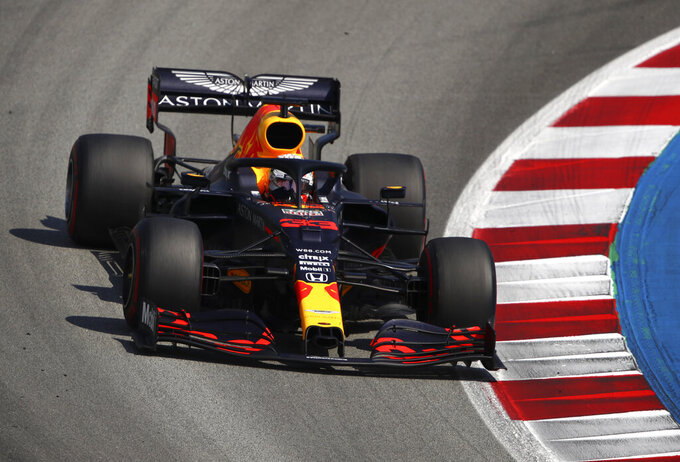 Red Bull driver Max Verstappen of the Netherlands steers his car during the Formula One Grand Prix at the Barcelona Catalunya racetrack in Montmelo, Spain, Sunday, Aug. 16, 2020. (Bryn Lennon, Pool via AP)