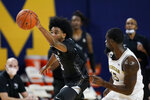 Central Florida forward Isaiah Adams (3) steals the ball away from Michigan guard Chaundee Brown (15) during the first half of an NCAA college basketball game, Sunday, Dec. 6, 2020, in Ann Arbor, Mich. (AP Photo/Carlos Osorio)