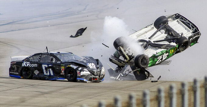 Monster Energy NASCAR Cup Series driver Kyle Larson (42) flips as he makes contact with Monster Energy NASCAR Cup Series driver Jeffrey Earnhardt (81) on the back stretch during the Geico 500 at Talladega Superspeedway, Sunday, April 28, 2019, in Talladega, Ala. (AP Photo/Greg McWilliams)