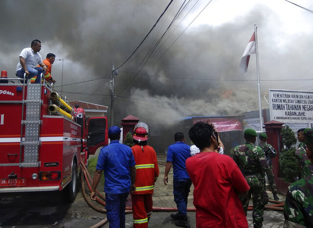 Smoke billows from Kabanjahe prison during a prison riot in Kabanjahe, North Sumatra, Indonesia, Wednesday, Feb. 12, 2020. Angry inmates set fire to the overcrowded prison on Indonesia's Sumatra island during a riot that erupted Wednesday, officials said. (AP Photo)