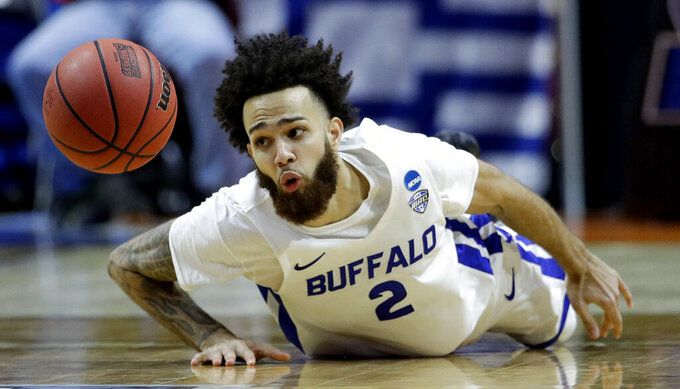 Buffalo's Jeremy Harris chases after a loose ball during the second half of a first round men's college basketball game against Arizona State in the NCAA Tournament Friday, March 22, 2019, in Tulsa, Okla. (AP Photo/Charlie Riedel)