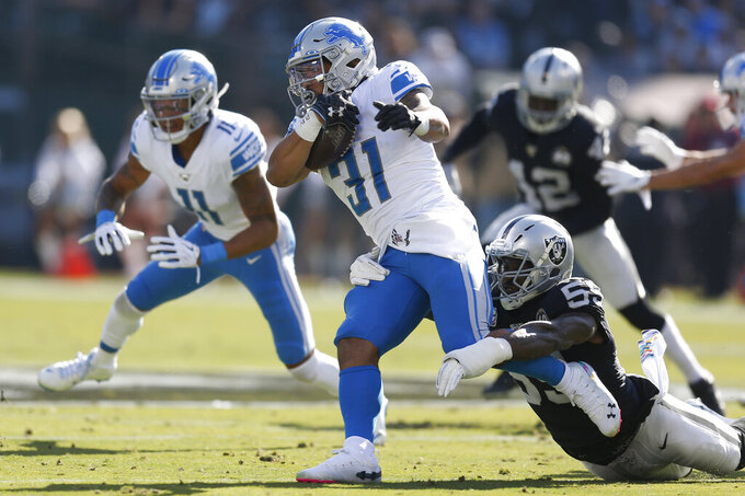 Detroit Lions running back Ty Johnson (31) runs against Oakland Raiders outside linebacker Tahir Whitehead during the first half of an NFL football game in Oakland, Calif., Sunday, Nov. 3, 2019. (AP Photo/D. Ross Cameron)