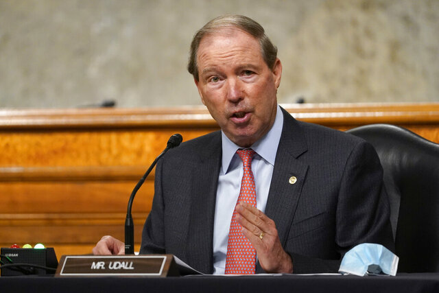 FILE - In this Sept. 24, 2020 file photo, Sen. Tom Udall, D-N.M., speaks during a Senate Foreign Relations Committee hearing on Capitol Hill in Washington.  Udall is retiring from the Senate, but has emerged as a leading contender to be Interior secretary under President-elect Joe Biden. If chosen, the Democrat would follow in the footsteps of his father, Stewart Udall, a former congressman who led Interior under two Democratic presidents in the 1960s.  (AP Photo/Susan Walsh, Pool)