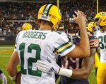 Green Bay Packers' Aaron Rodgers talks to Chicago Bears' Eddie Jackson after an NFL football game against the Chicago Bears Thursday, Sept. 5, 2019, in Chicago. The Packers won 10-3. (AP Photo/Morry Gash)