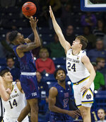 Fairleigh Dickinson's Xzavier Malone-Key (5) shoots over Notre Dame's Robby Carmody (24)  during an NCAA college basketball game Tuesday, Nov. 26, 2019, in South Bend, Ind. (Michael Caterina/South Bend Tribune via AP)