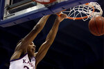 Kansas' Ochai Agbaji dunks the ball during the first half of an NCAA college basketball game against Baylor Saturday, March 9, 2019, in Lawrence, Kan. (AP Photo/Charlie Riedel)