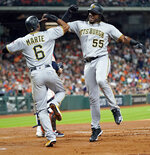 Pittsburgh Pirates' Josh Bell (55) celebrates with Starling Marte (6) after both scored on Bell's home run against the Houston Astros during the third inning of a baseball game Thursday, June 27, 2019, in Houston. (AP Photo/David J. Phillip)