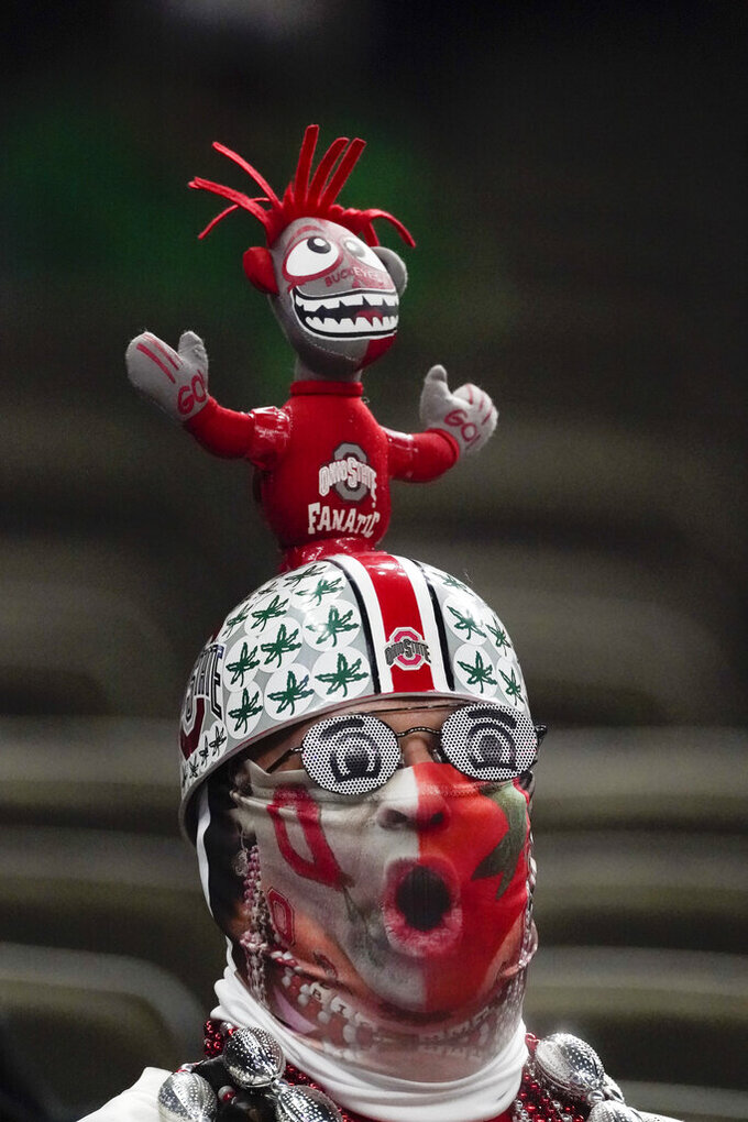 A Ohio State fan reacts during the second half of the Sugar Bowl NCAA college football game against Clemson Friday, Jan. 1, 2021, in New Orleans. (AP Photo/John Bazemore)