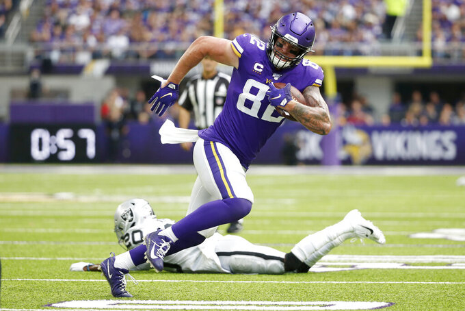 Minnesota Vikings tight end Kyle Rudolph (82) runs from Oakland Raiders cornerback Daryl Worley (20) after making a reception during the first half of an NFL football game, Sunday, Sept. 22, 2019, in Minneapolis. (AP Photo/Bruce Kluckhohn)