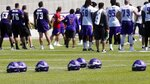 Helmets lay on the field as Minnesota Vikings players took part in some drills without helmets during the NFL football team's training camp Friday, July 26, 2019, in Eagan, Minn. (AP Photo/Jim Mone)