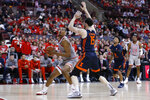 Ohio State's Kaleb Wesson, left, posts up against Illinois' Giorgi Bezhanishvili during the second half of an NCAA college basketball game Thursday, March 5, 2020, in Columbus, Ohio. Ohio State won 71-63. (AP Photo/Jay LaPrete)