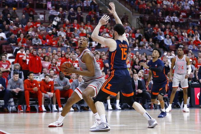 Ohio State's Kaleb Wesson, left, posts up against Illinois' Giorgi Bezhanishvili during the second half of an NCAA college basketball game Thursday, March 5, 2020, in Columbus, Ohio. Ohio State won 71-63. (AP Photo/Jay LaPrete)