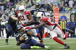 Seattle Seahawks quarterback Russell Wilson (3) slides to avoid a tackle by Arizona Cardinals linebacker Chandler Jones, right, during the first half of an NFL football game, Sunday, Dec. 22, 2019, in Seattle. (AP Photo/Lindsey Wasson)