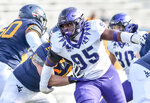 TCU  defensive tackle Terrell Cooper (95) works around West Virginia offensive lineman Zach Frazier (54) during the first half of an NCAA college football game on Saturday, Nov. 14, 2020, in Morgantown, W.Va. (William Wotring/The Dominion-Post via AP)