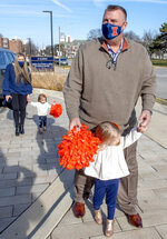 University of Illinois' new football coach Bret Bielema and his family, wife Jen and daughters Briella, front, and Brexli were introduced to the media outside the Smith Center on UI campus in Champaign, Ill. on Sunday, Dec. 20 , 2020. (Robin Scholz/The News-Gazette via AP)