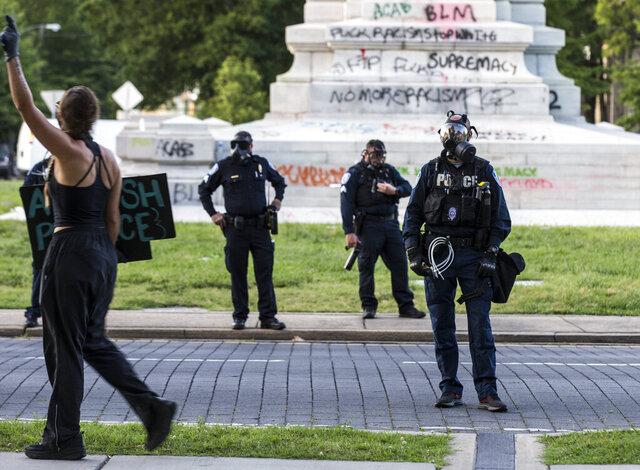 Police guard Robert E. Lee Statue in Richmond, Va., Monday, June 1, 2020. (Daniel Sangjib Min/Richmond Times-Dispatch via AP)
