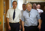 FILE - In this Friday, Nov. 22, 2019 file photo, Britain's  Prime Minister Boris Johnson, right, and Health Minister Matt Hancock visit Bassetlaw District General Hospital on their General Election campaign in Worksop, England. Matt Hancock has tested positive for the new coronavirus, Friday March 27, 2020, the same day as Prime Minister Boris Johnson was confirmed to have COVID-19. (Christopher Furlong/Pool via AP, File)