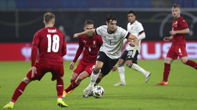 Germany's Florian Neuhaus controls the ball during the friendly soccer match between Germany and Czech Republic in Leipzig, Germany, Wednesday, Nov. 11, 2020. (AP Photo/Michael Sohn)