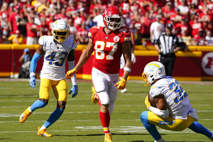 Los Angeles Chargers' Alohi Gilman (32) intercepts a pass intended for Kansas City Chiefs' Travis Kelce (87) during the second half of an NFL football game, Sunday, Sept. 26, 2021, in Kansas City, Mo. Los Angeles won 30-24. (AP Photo/Ed Zurga)